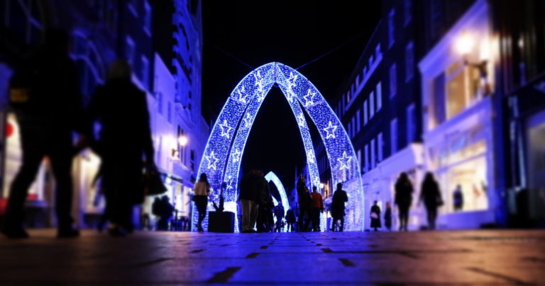 Arch of Christmas lights in city of London