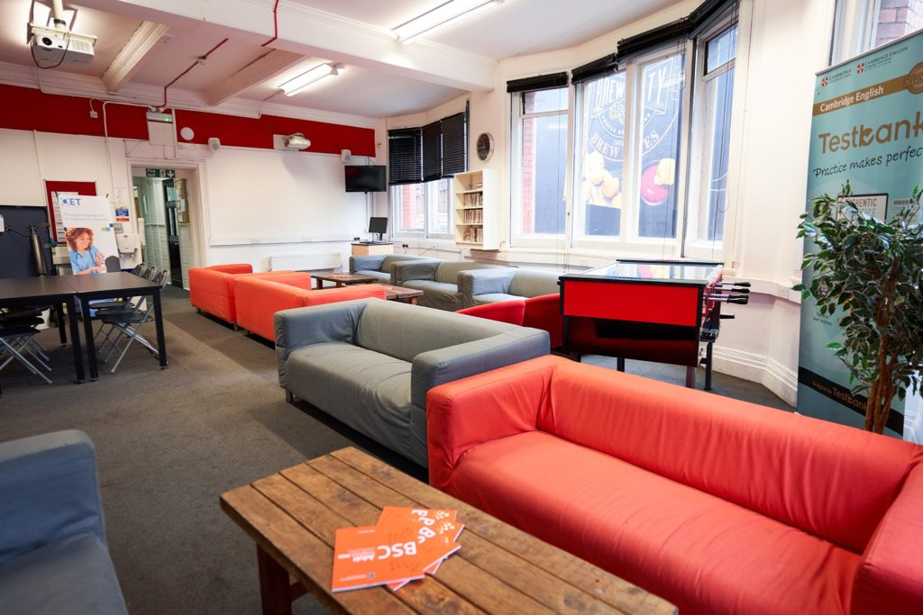 Student lounge at BSC Manchester with sofas, TV screen and fussball table