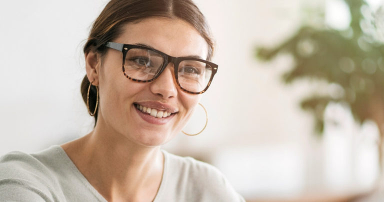 woman with glasses in job interview