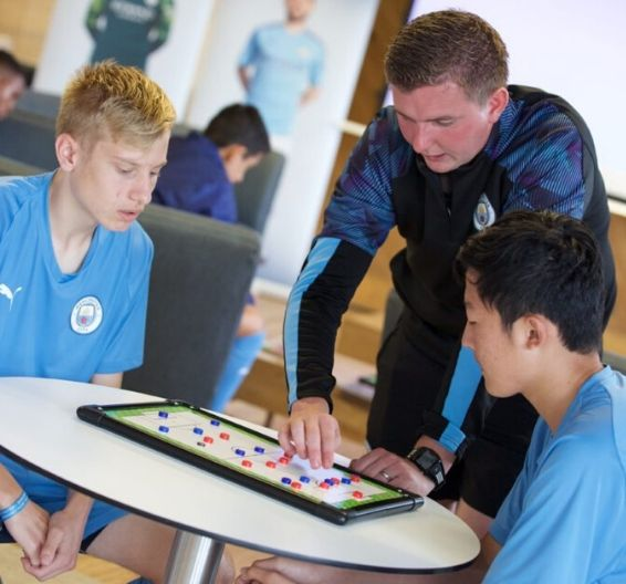 Manchester City Academy Coaches teaching players in class