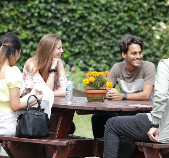 Brighton students chatting in the patio