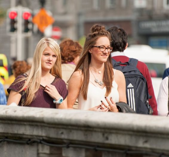 Two female students exploring Dublin on a bridge.