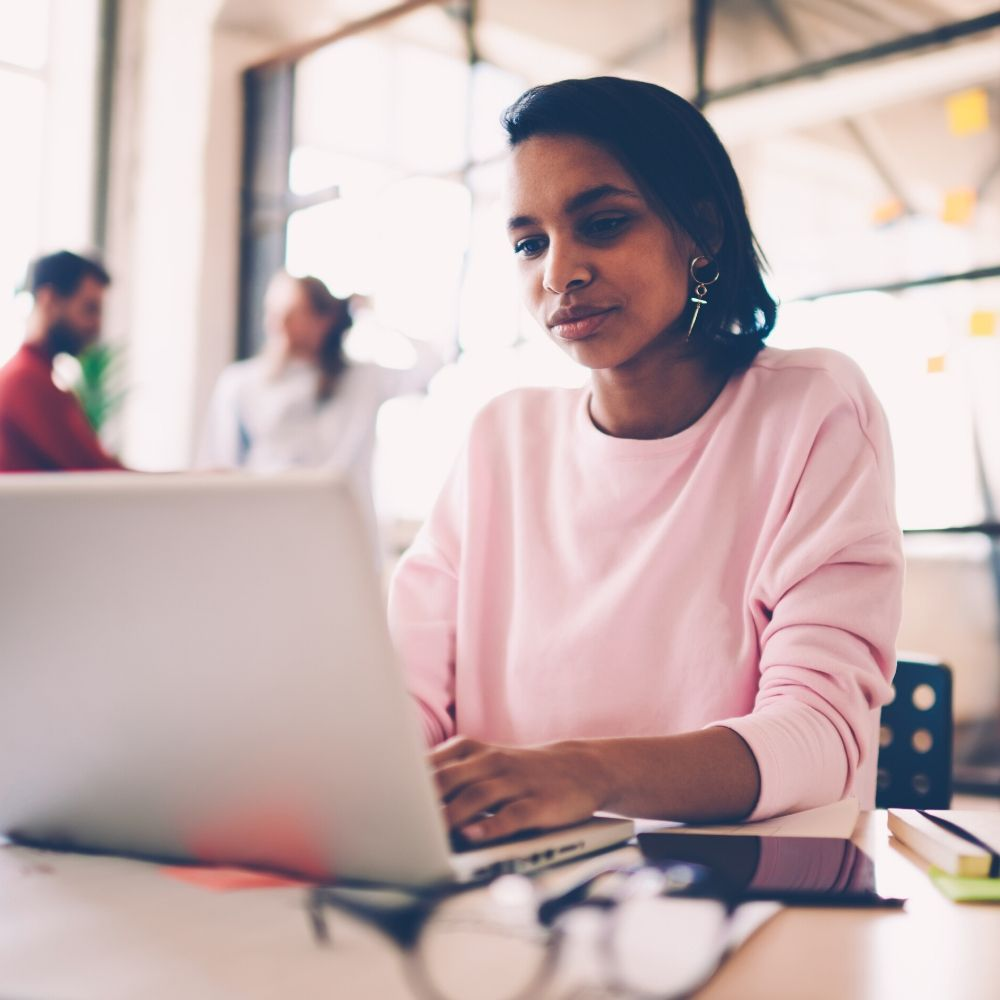 Woman in office learns English online