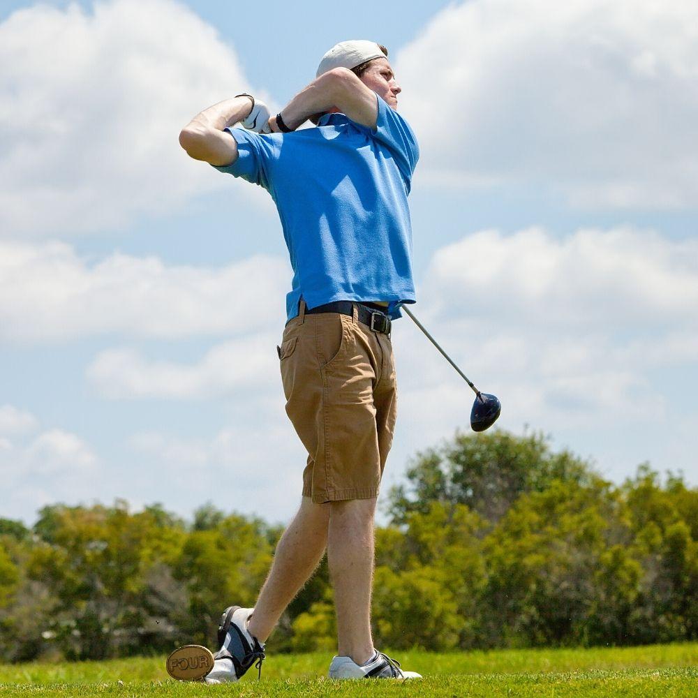 Boy practising golf