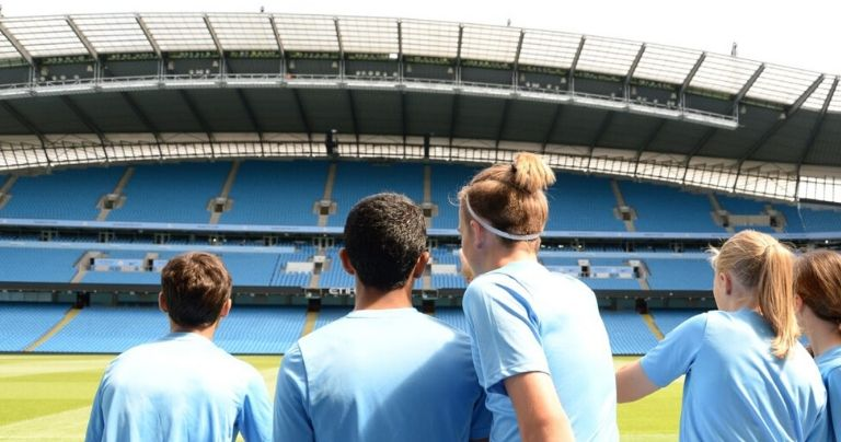 Young players taking a tour of the Etihad Stadium