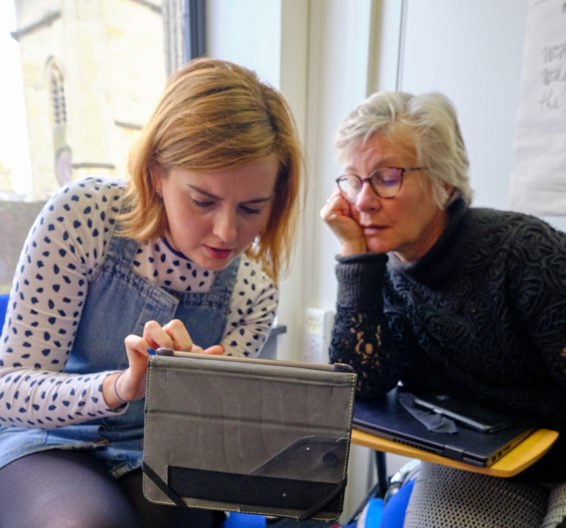 Two students using an iPad in BSC Oxford