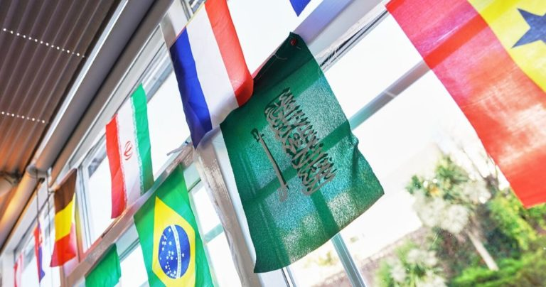 International flags hanging in a window