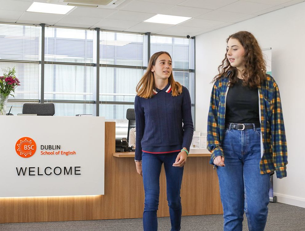 Two teenage girls walk past the modern reception desk at BSC Dublin