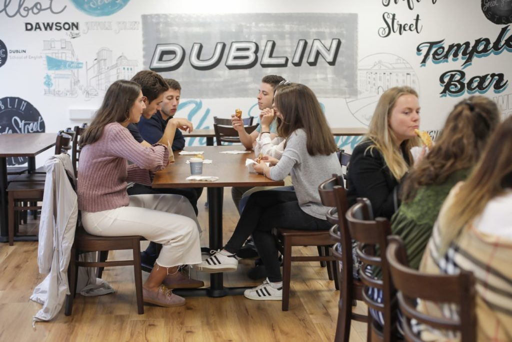 Group of students chatting over coffees in the BSC Dublin cafe