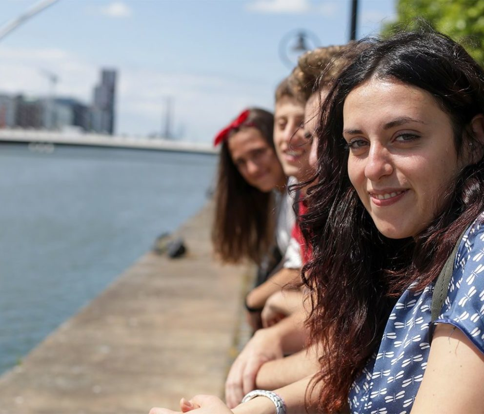 Students smiling along the river Liffey quays