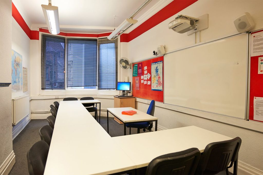 Bright classroom with empty chairs at BSC Manchester