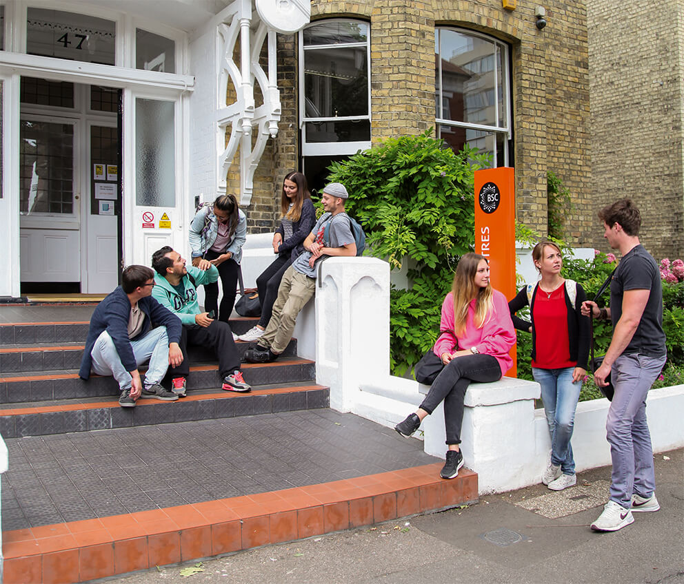 Students talking on the steps outside BSC Brighton