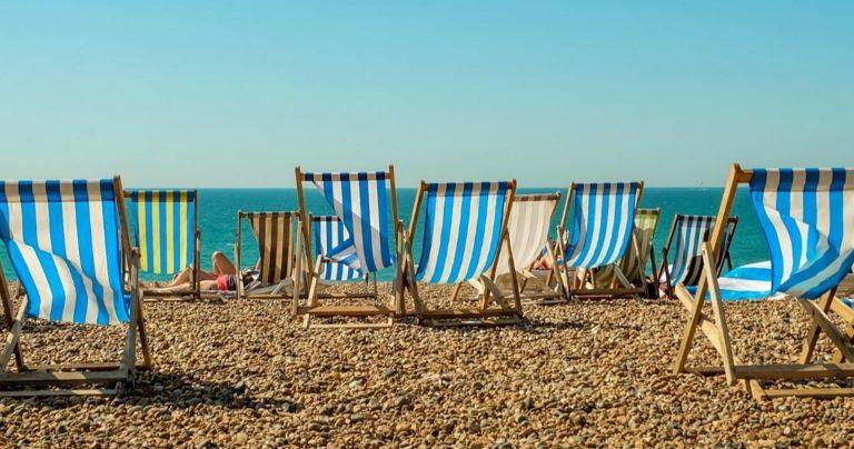 Deckchairs in sunshine on Brighton beach