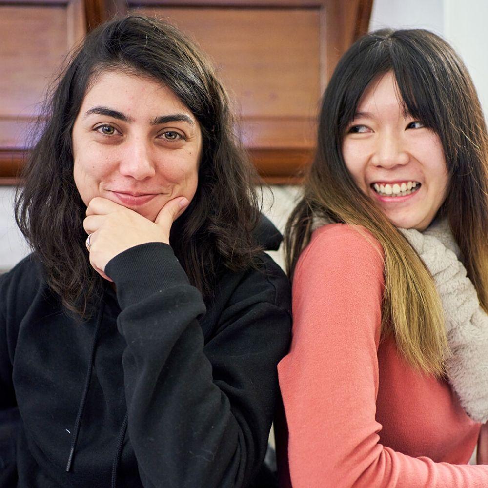 Two women in a classroom in BSC London sat side by side