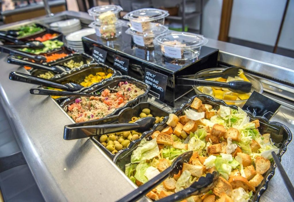 Close up of salad bar with a variety of options