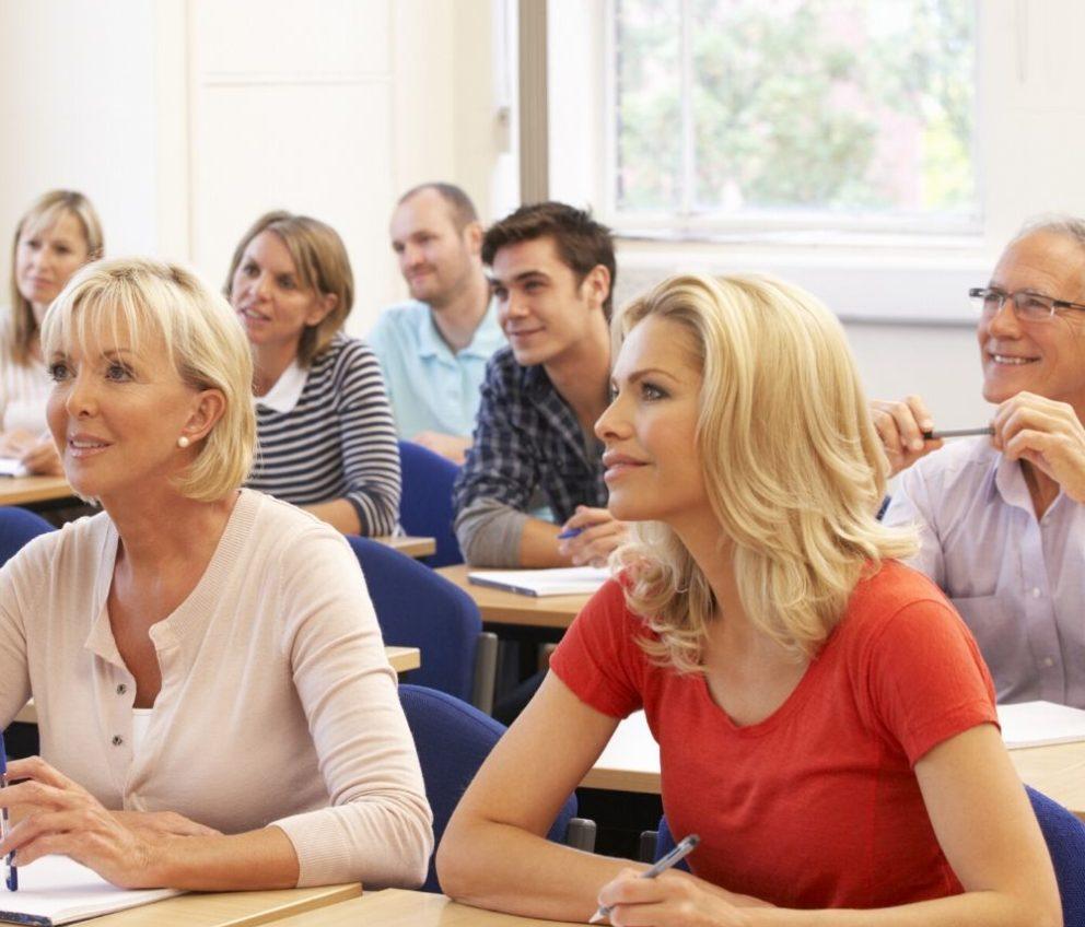 Trainee teachers listening in class