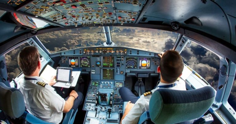 Pilots in training in a cockpit