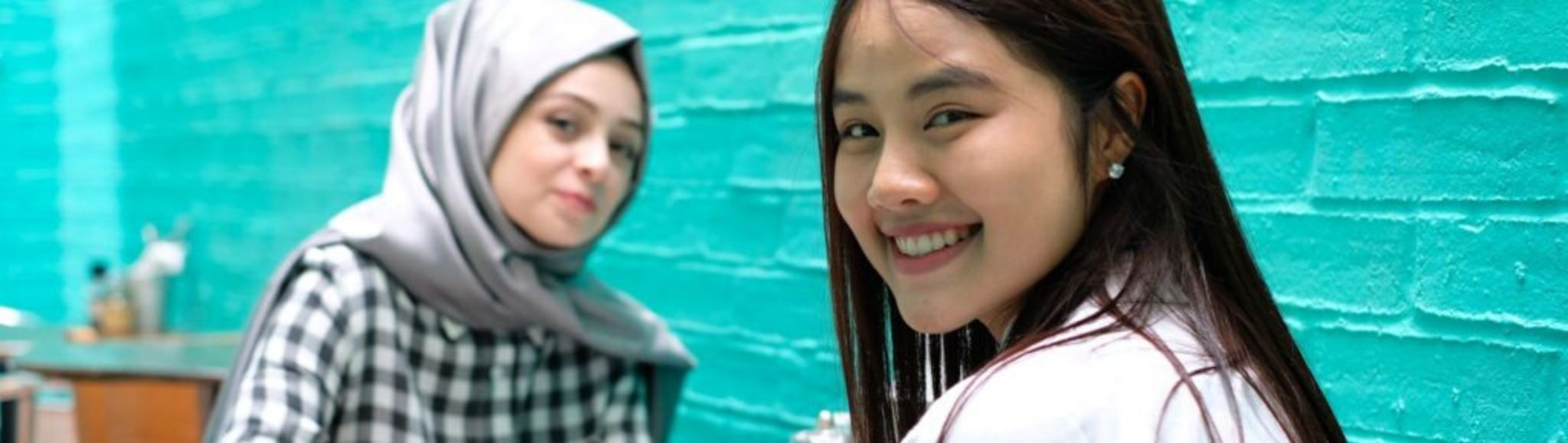 two students smiling at the camera