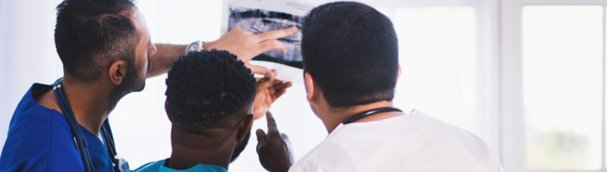 medical staff looking at x-ray