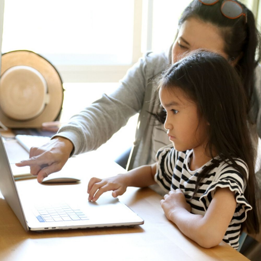 Asian mother and child learn a language together online