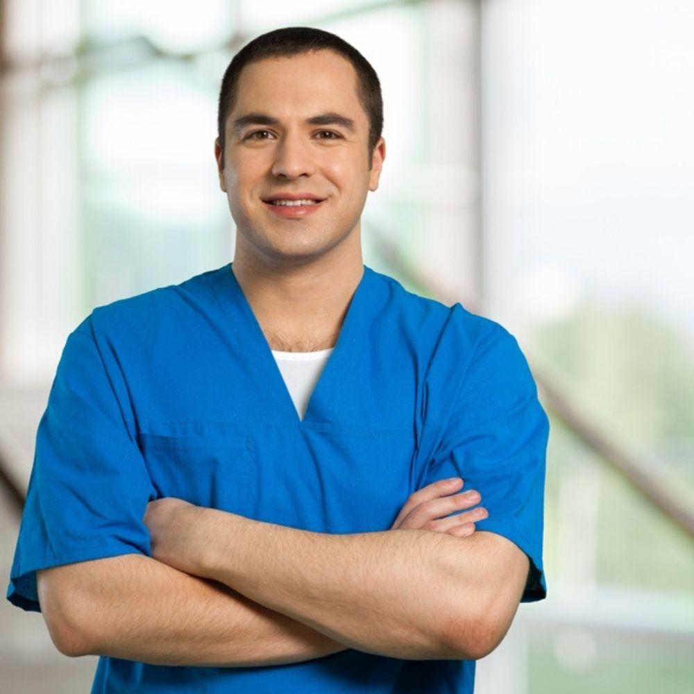 Male nurse at hospital window
