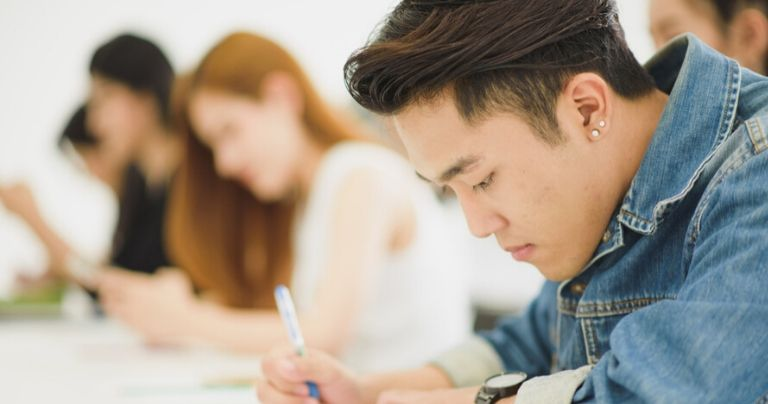 Male Asian student studying for University