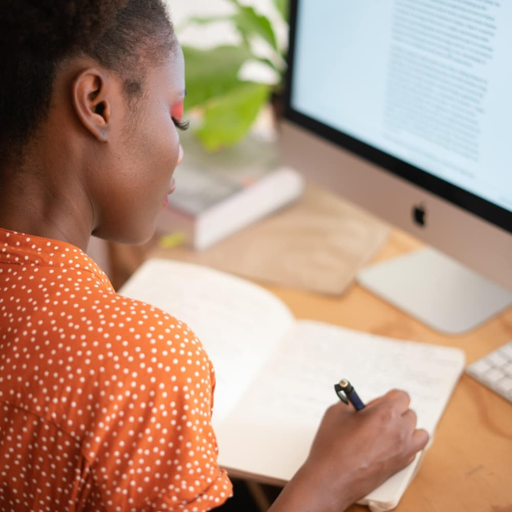 woman studying in front of computer