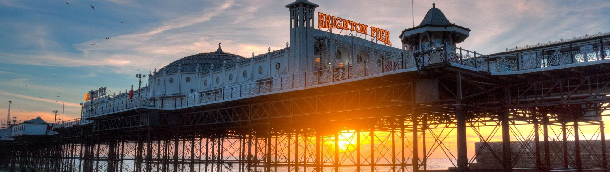 sunset through Brighton Pier