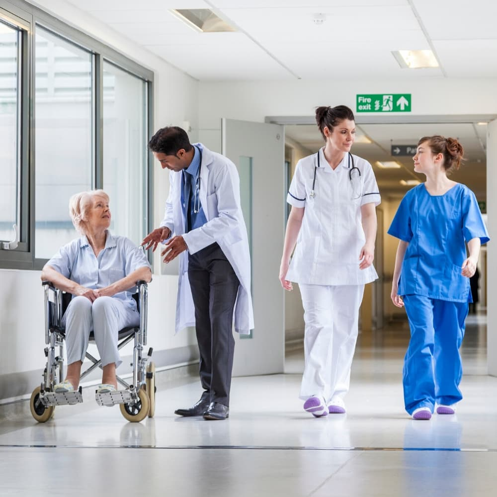nurses and doctors in a hopsital corridor