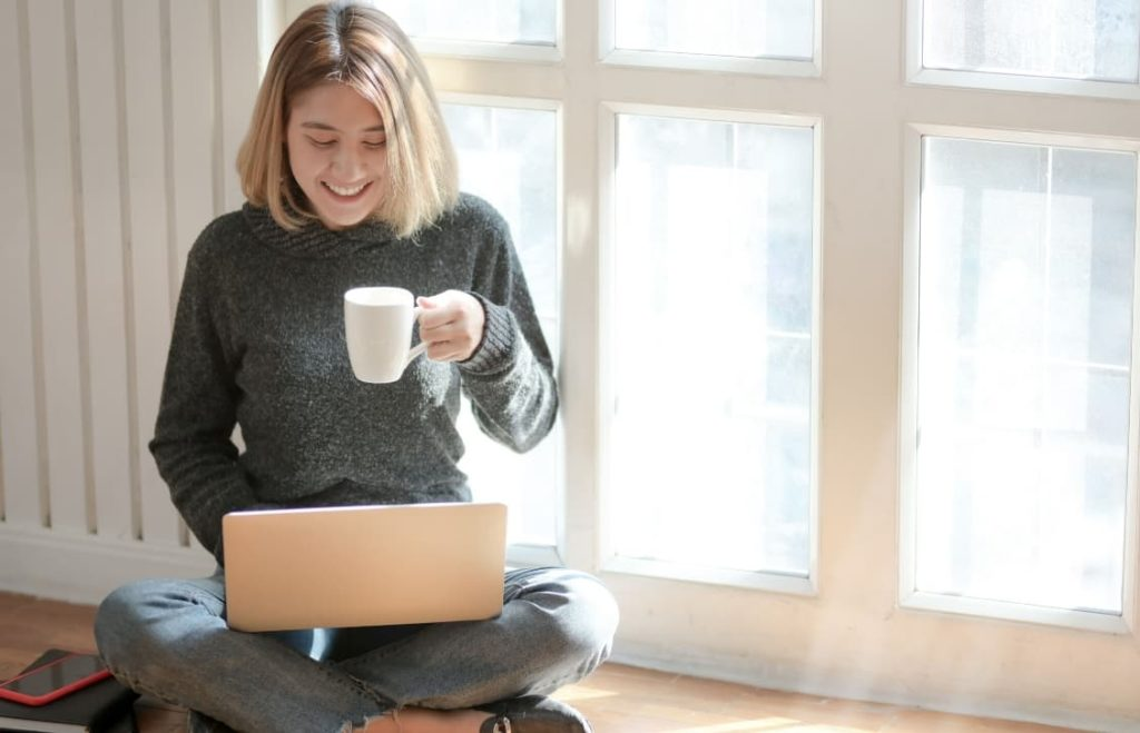 woman working online and drinking coffee