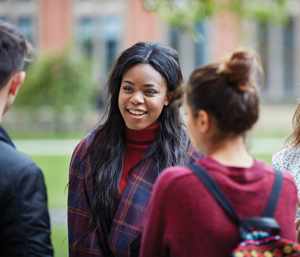 students chatting outside the University of Birmingham