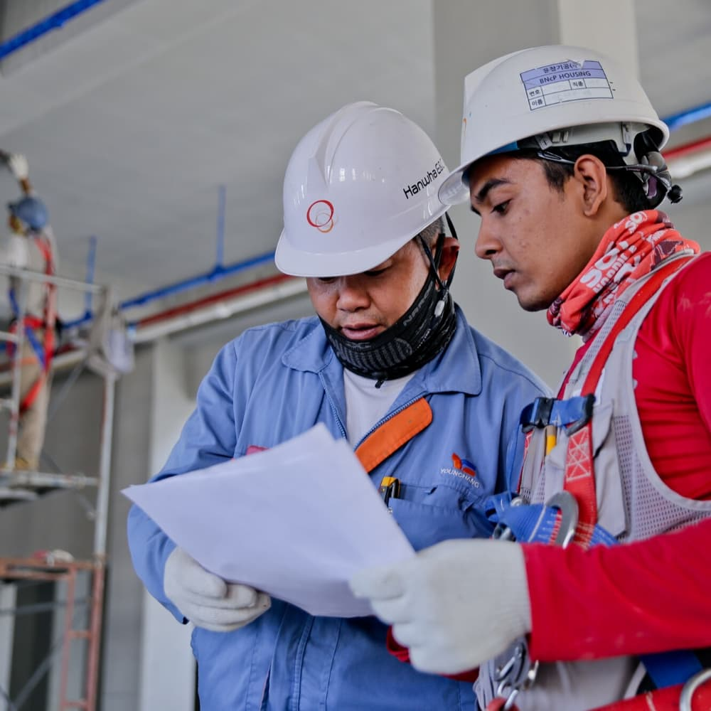 two workers wearing hard hats