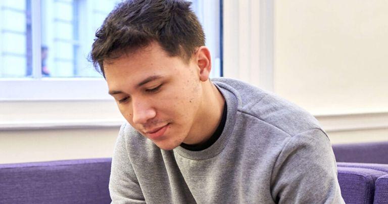 Student on purple sofa on humanities international foundation year