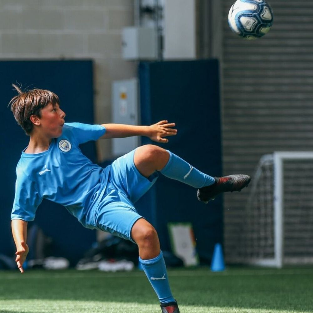 Boy on Manchester City football course