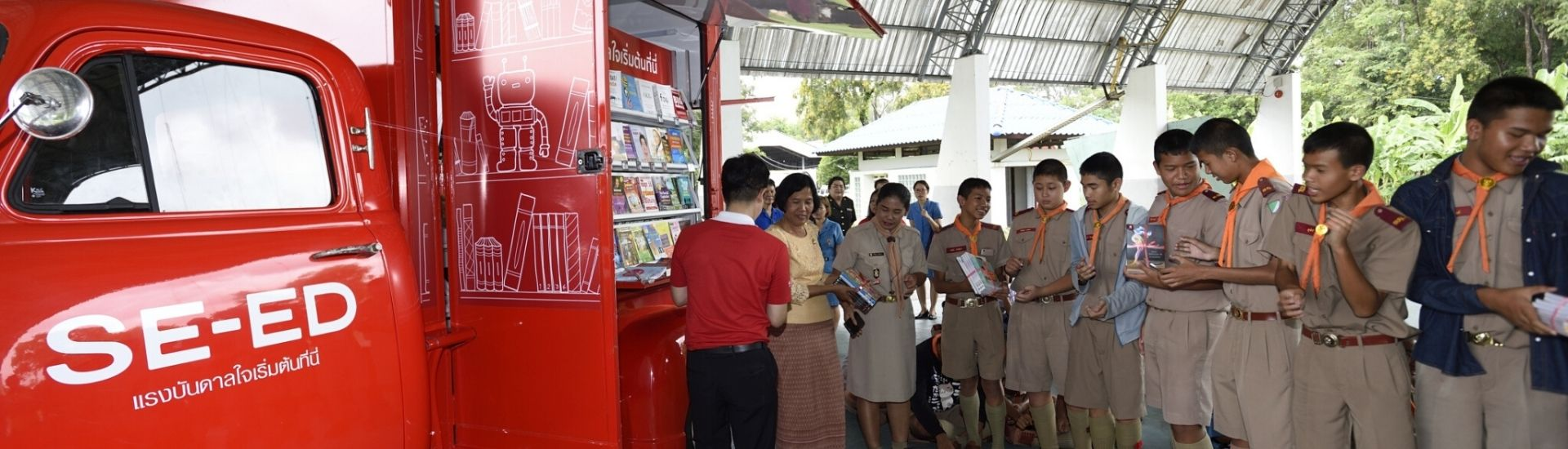 Children waiting to receive free books at the Red Truck in Thailand