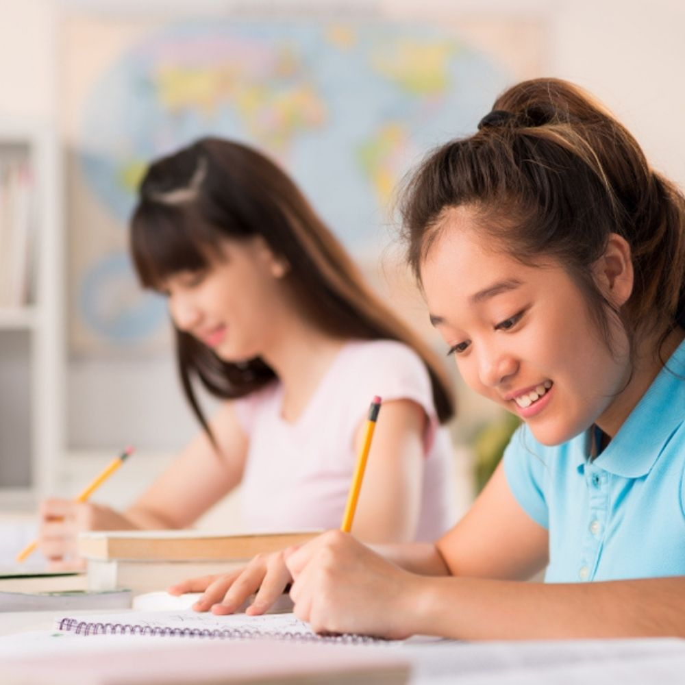 Two Asian Young Learners learn English