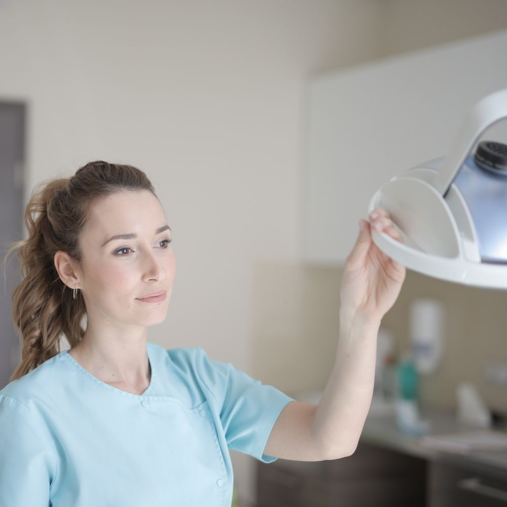 Female dentist nurse at work after passing oet exam with an online oet course