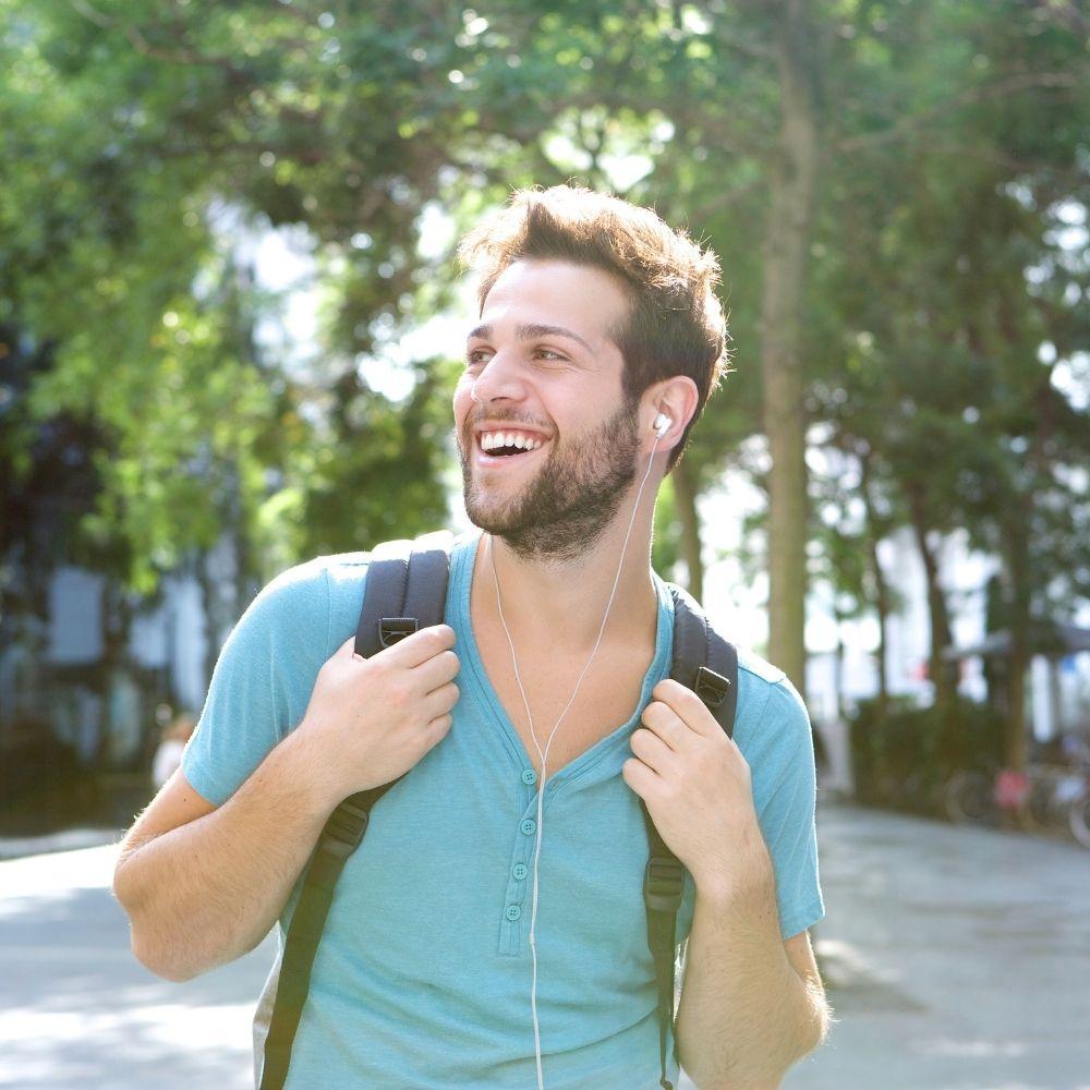 man smiling walking