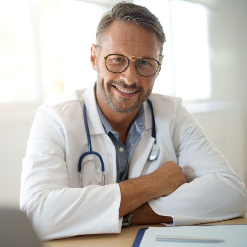 Smiling doctor at surgery