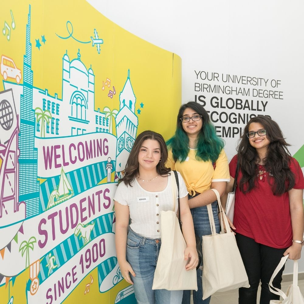 Students by sign at the University of Birmingham Dubai
