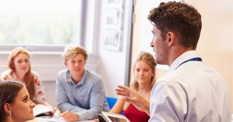 Man completes teaching practice in blended celta class