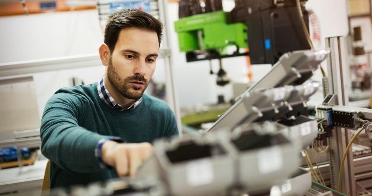 Male engineer with machine