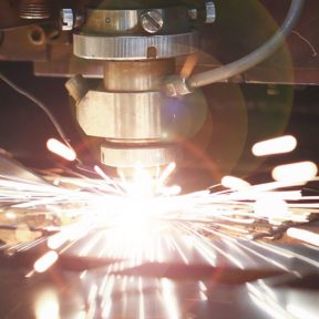 Sparks fly as industrial machinery operates