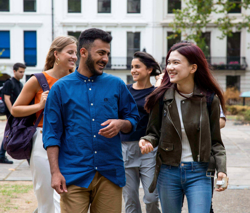 A group of male and female university pathways students walking through London