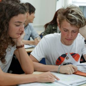 Two teenage students focus on Cambridge Exam preparation