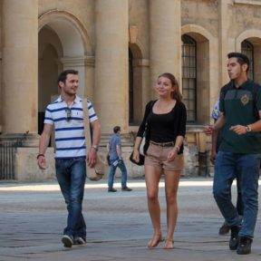 Group of students exploring a city on foot