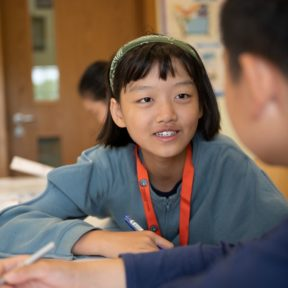 Girl and boy learning English at Summer Camp