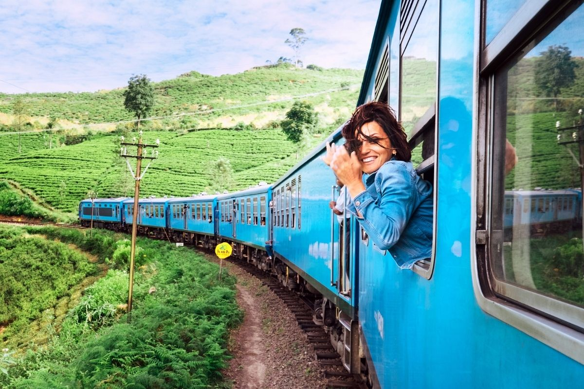 Girl takes train through jungle